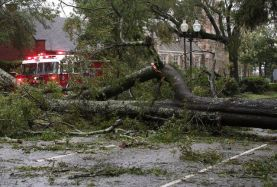 WILMINGTON, NC- SEPTEMBER 14: A fire truck drives past a large tree blown over by Hurricane Florence on September 14, 2018 in Wilmington, North Carolina. Hurricane Florence hit Wilmington as a category 1 storm causing widespread damage and flooding along the Carolina coastline. (Photo by Mark Wilson/Getty Images)