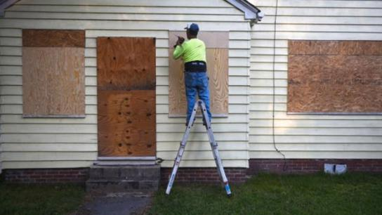 A man secures plywood to protect a window of a property ahead of Hurricane Florence in Greenville, N.C., on Sept. 12, 2018. MUST CREDIT: Bloomberg photo by Callaghan O'Hare.