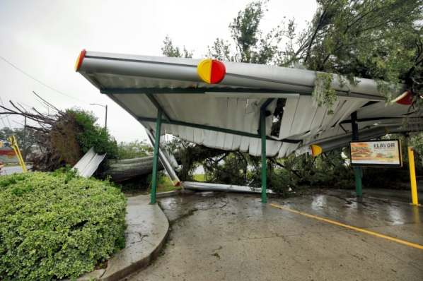 hurricane-florence-fallen-tree-lies-atop-the-crushed-roof